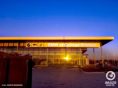 bmw-college-station-routed-push-through-building-sign-car-dealership